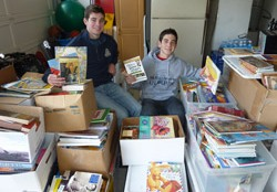 Nick and Michael Camarda sorting donated books