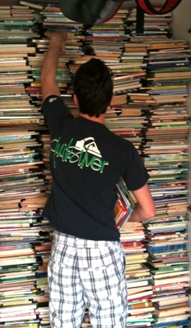 Nick Camarda storing donated books